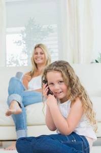 Daughter using mobile phone