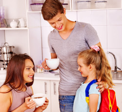 Parents prepare  child for school. Happy family.
